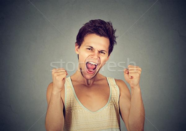 Heureux réussi étudiant homme gagner célébrer Photo stock © ichiosea