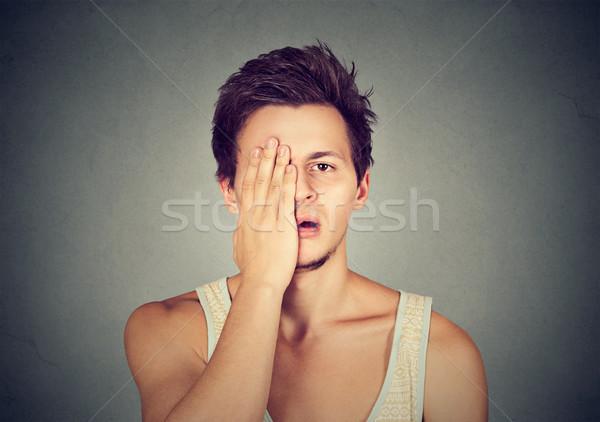 Désespérée malheureux triste jeune homme homme isolé Photo stock © ichiosea
