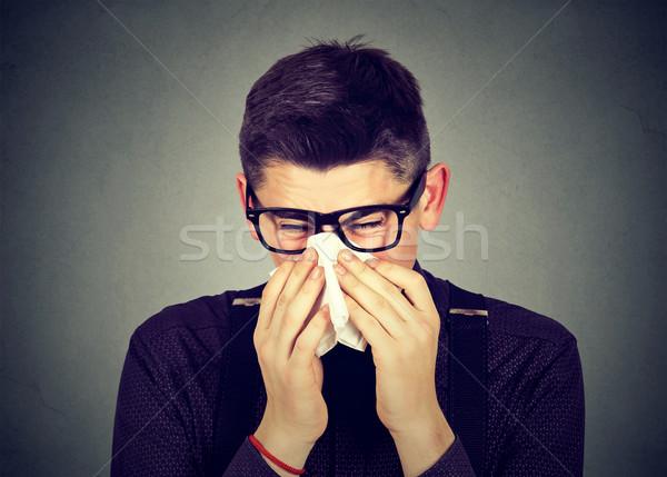 Férfi szemüveg papírzsebkendő fúj orr fiatalember Stock fotó © ichiosea