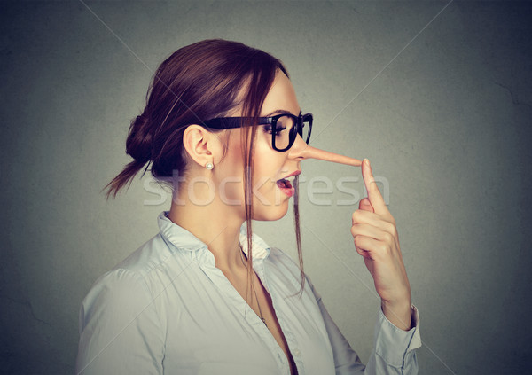 Woman with long nose. Liar concept. Stock photo © ichiosea