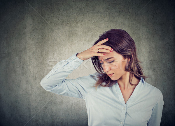 sad young beautiful woman with worried stressed face expression Stock photo © ichiosea