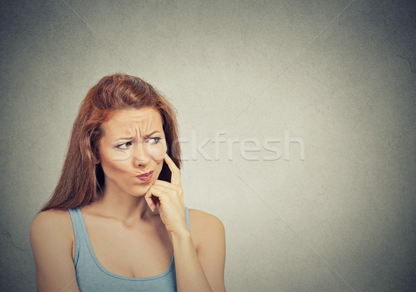 thoughtful skeptical suspicious young woman  Stock photo © ichiosea
