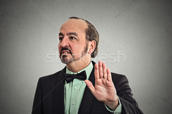 grumpy man with bad attitude giving talk to hand gesture  Stock photo © ichiosea