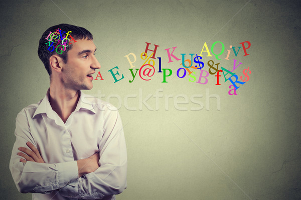 Side view portrait man talking with alphabet letters in his head coming out of open mouth  Stock photo © ichiosea