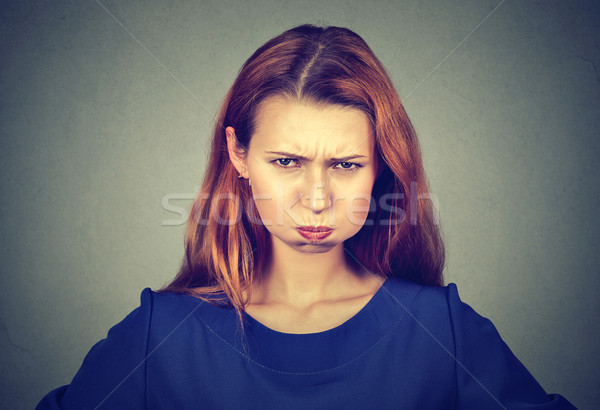 Stock photo: angry young woman, puffing out cheeks about to have nervous breakdown