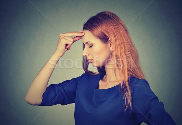 Lado perfil triste mulher jovem preocupado Foto stock © ichiosea