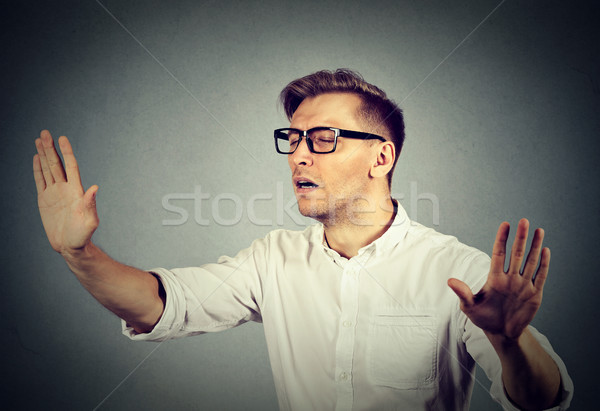 blindfolded business man stretching arms out eyes closed sightless  Stock photo © ichiosea