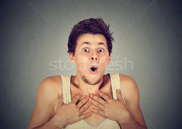 shocked surprised young man in full disbelief with hands on chest  Stock photo © ichiosea