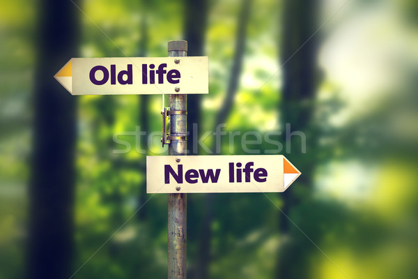 Signpost in a park with arrows old and new life pointing in two opposite directions Stock photo © ichiosea