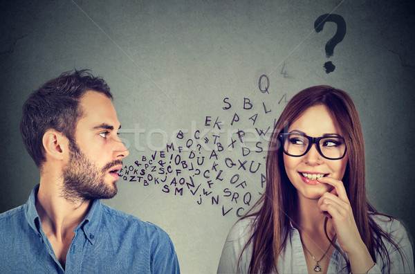 Language barrier. Man talking to an attractive woman with question mark  Stock photo © ichiosea