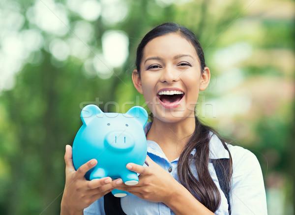 Happy woman holding piggy bank Stock photo © ichiosea