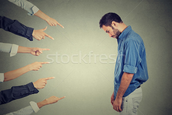 accusation of guilty person man. man looking down fingers pointing at him Stock photo © ichiosea