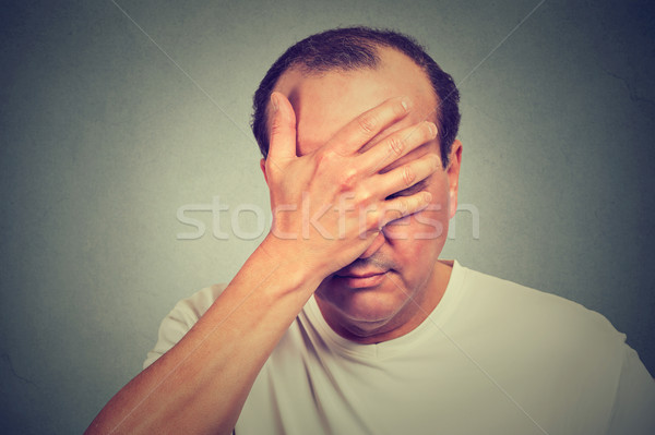 portrait of middle aged desperate man isolated on gray wall background  Stock photo © ichiosea