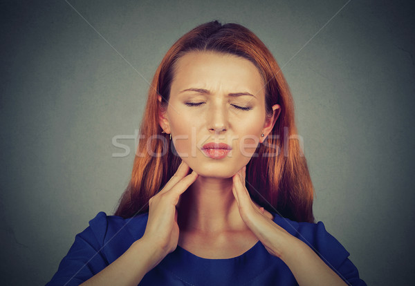 Sick young woman having pain in her throat  Stock photo © ichiosea