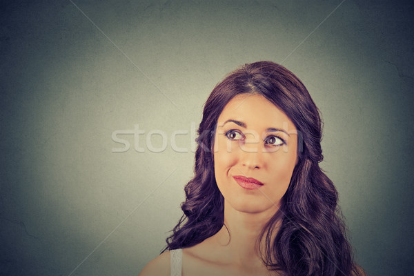 confused skeptical woman thinking planning looking up  Stock photo © ichiosea