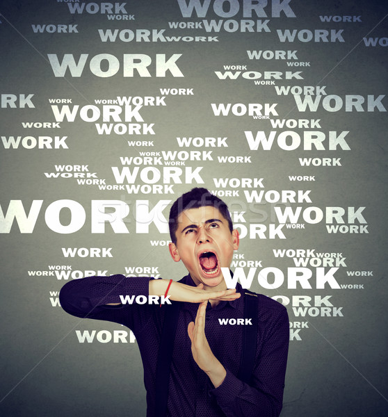 Stressed man showing time out overwhelmed by long working hours   Stock photo © ichiosea