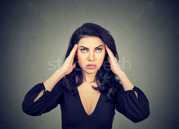 Stressed anxious young woman with headache.  Stock photo © ichiosea