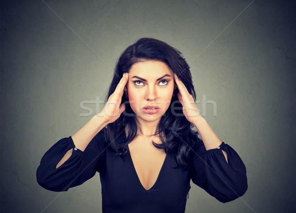 Niespokojny młoda kobieta głowy odizolowany szary Zdjęcia stock © ichiosea
