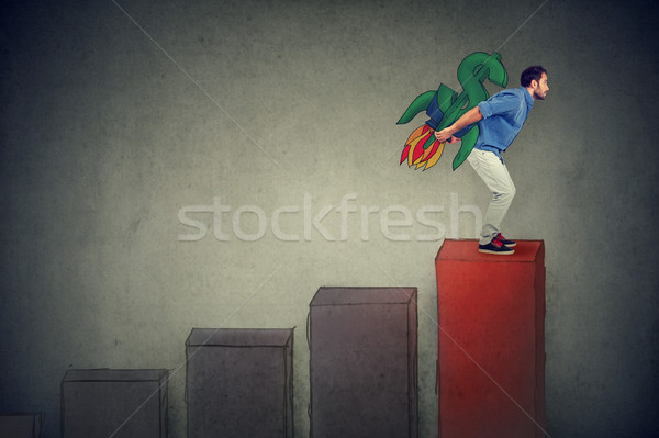 ambitious young man with high risky financial goals heading for a growth  Stock photo © ichiosea