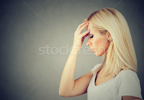 Sorrowful sad woman thoughtful with worried face expression   Stock photo © ichiosea