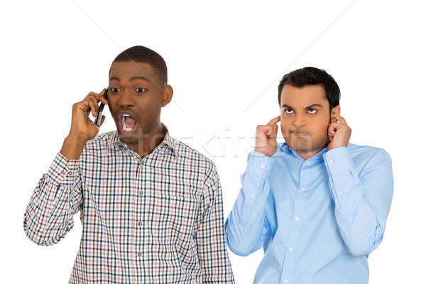 one man annoyed with another who talks loudly over the phone Stock photo © ichiosea