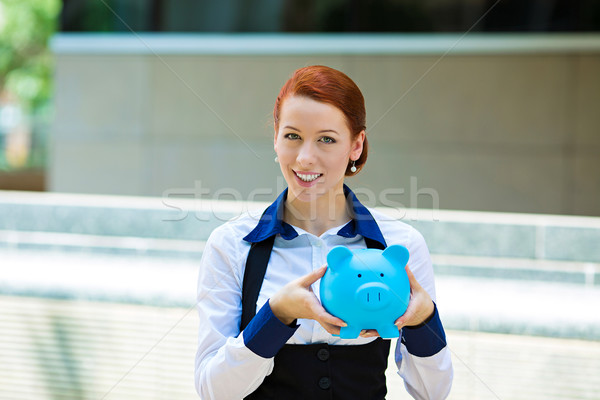 Happy woman, corporate employee holding piggy bank Stock photo © ichiosea