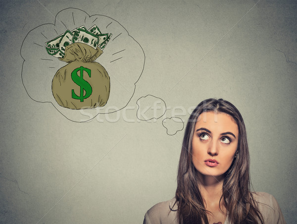 Woman dreaming of financial success a lot of money  Stock photo © ichiosea