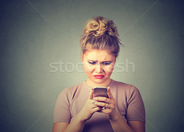 Sad upset woman using mobile phone  Stock photo © ichiosea