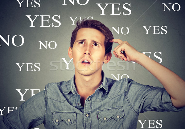 Thinking perplexed man with yes or no choice looking up  Stock photo © ichiosea
