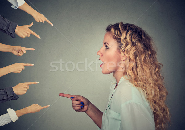 Side profile shocked girl pointing against many fingers Stock photo © ichiosea