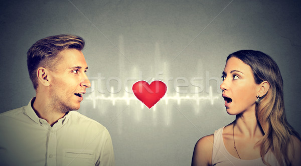 Love connection. Man woman talking to each other with heart in-between   Stock photo © ichiosea
