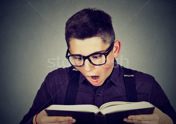 Amazed man reading a book Stock photo © ichiosea
