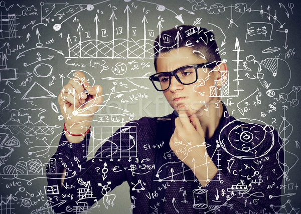 Smart business man writing formulas or science financial calculations  Stock photo © ichiosea