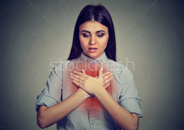 Young woman with asthma attack or respiratory problem  Stock photo © ichiosea