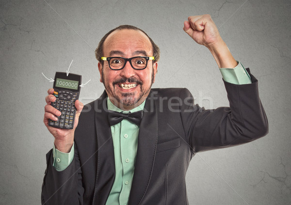 businessman showing calculator with million sign on screen Stock photo © ichiosea
