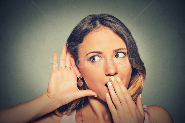 surprised young nosy woman hand to ear gesture carefully secretly listening Stock photo © ichiosea