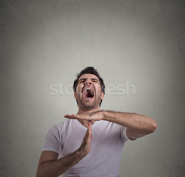 man showing time out hand gesture, frustrated screaming to stop Stock photo © ichiosea