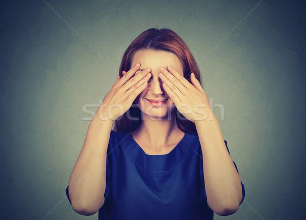 Ukrywanie uśmiechnięty nieśmiała kobieta oczy dziewczyna Zdjęcia stock © ichiosea
