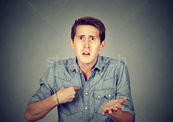 Angry, mad man pointing at himself asking you mean me? Stock photo © ichiosea