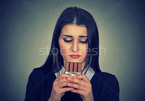sad woman tired of diet restrictions craving sweets chocolate Stock photo © ichiosea