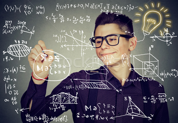 Smart guy writing high school maths and science formulas  Stock photo © ichiosea