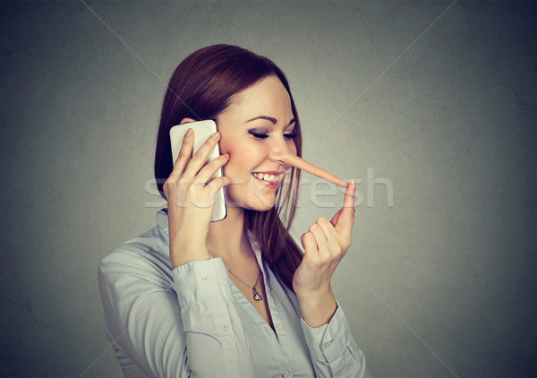 Happy young woman with long nose talking on mobile phone  Stock photo © ichiosea