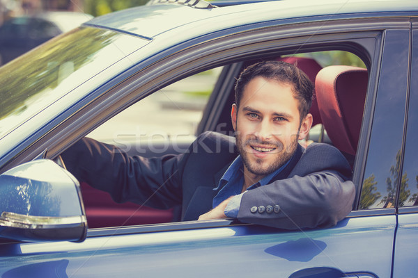 Happy smiling young man driving his new car.  Stock photo © ichiosea