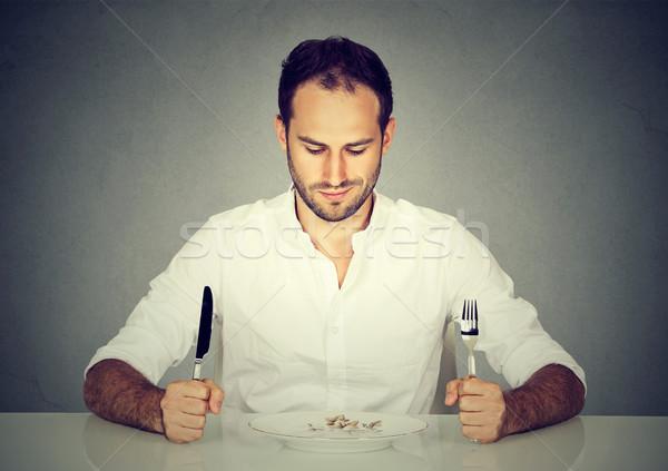 человека вилка ножом сидят таблице глядя Сток-фото © ichiosea