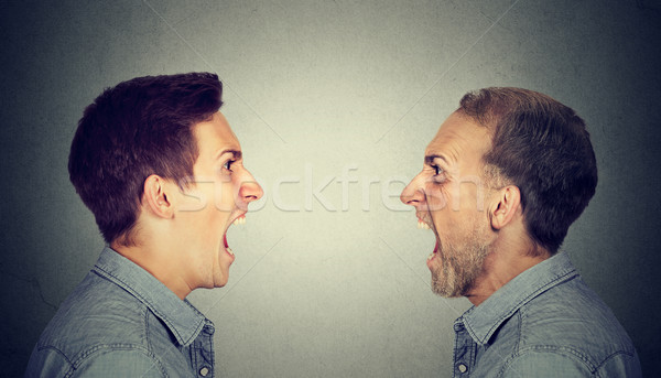 Angry young man screaming at old himself  Stock photo © ichiosea