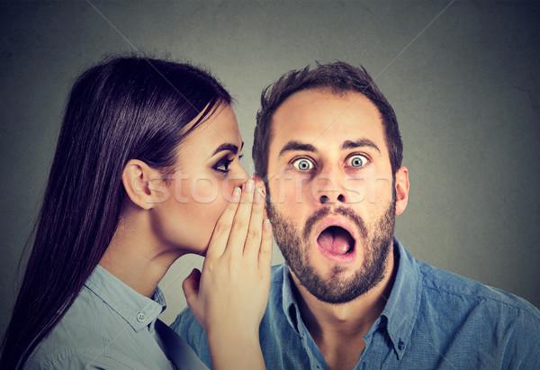 Latest rumors. Amazed man listening gossip in the ear  Stock photo © ichiosea