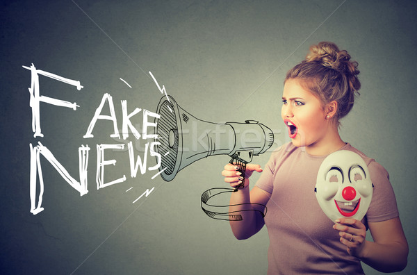 Woman screaming in a megaphone spreading fake news  Stock photo © ichiosea