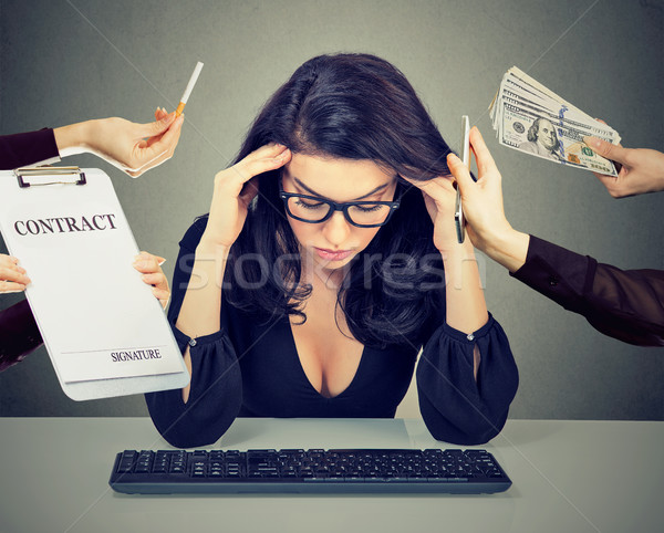 Overworked desperate woman leaning on a desk Stock photo © ichiosea