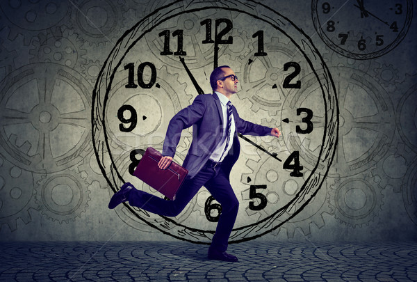 Mature business man in suit running on time Stock photo © ichiosea
