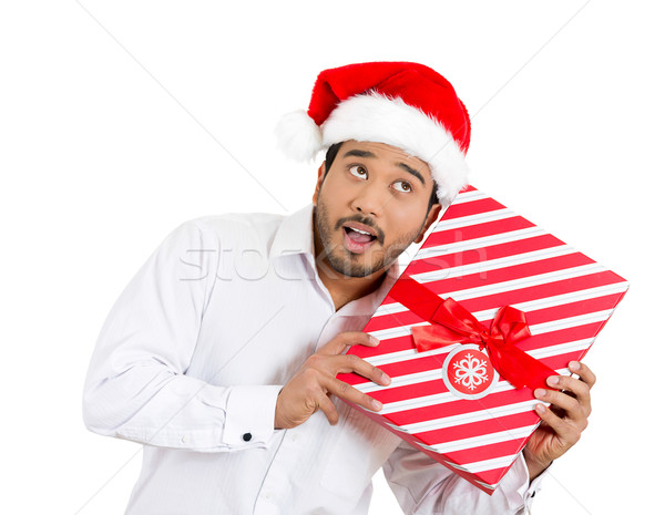 man trying to shake and listen to his wrapped gift Stock photo © ichiosea